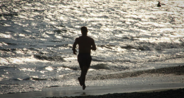man-running-on-the-beach
