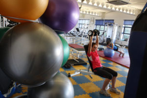 women exercise in the gym- reduce waistline
