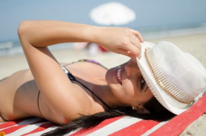women with hat on the beach