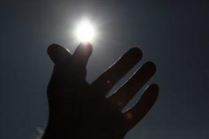 hormones hand touching sun