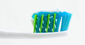 toothpaste on brush