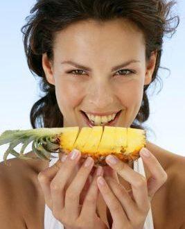 women eating pineapple