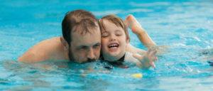 swim chiold with parent