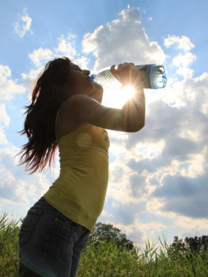 girl drinking water - the healthiest drink