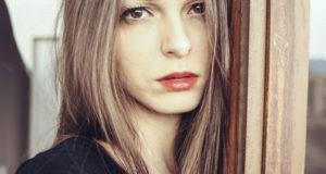 women by the window - hair myths
