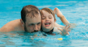 swim chiold with parent